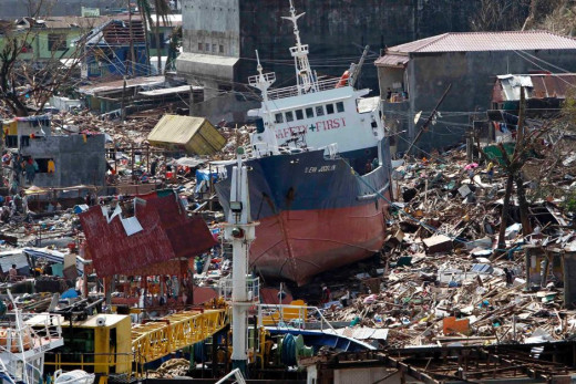 A cargo ship washed ashore by Typhoon Haiyan sits among the ruins