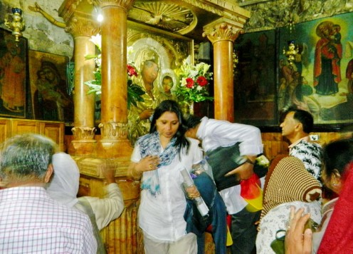 Visitors comes out after kissing the tomb of Mother Mary