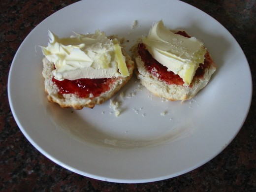 Plain sweet scones with clotted cream and jam.