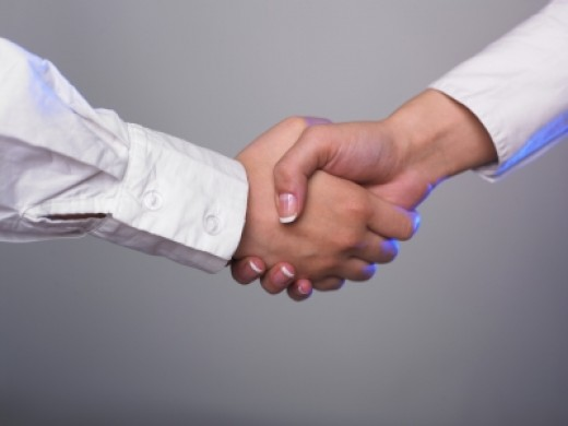 Shaking hands is another professional way to thank a person for a compliment.