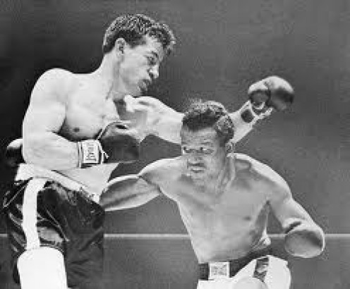 Sugar Ray Robinson knocked out Rocky Graziano in the third round in defense of his middleweight championship.
