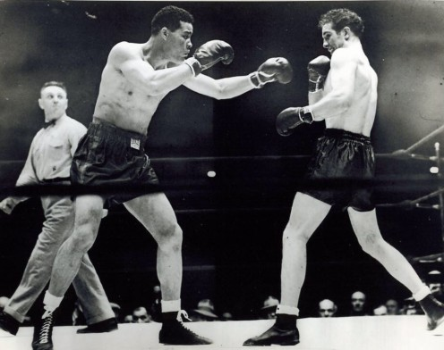 The Brown Bomber Joe Louis beat Billy Conn twice by knockout in defense of his heavyweight  championship.
