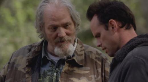 Bo (M.C. Gainey) and Boyd Crowder (Walton Goggins)