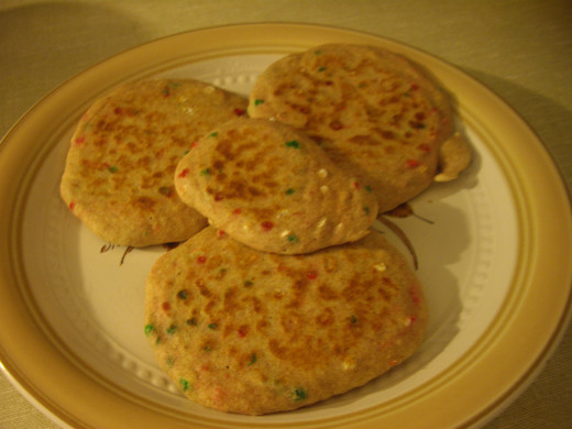 A plateful of pancakes, the sprinkles visible