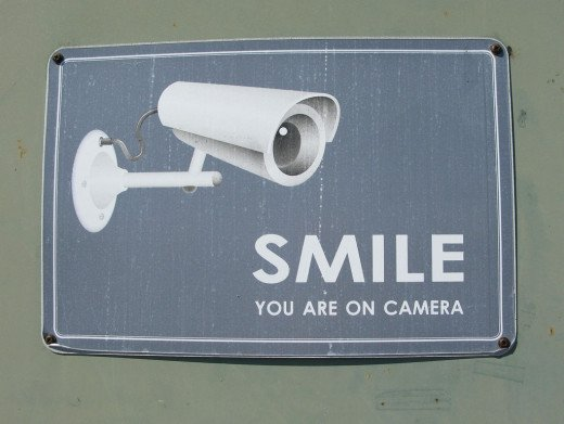 Signs like this are frequently used at businesses to alert would be thieves that they are on camera.
