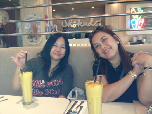 Friends enjoying the mango shake