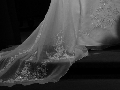The beautiful wedding gown train becomes a dim memory for a bride whose marriage is over.