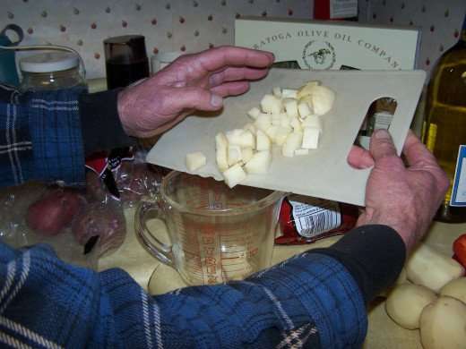 Here I use a plastic cutting board to dice the potatoes.