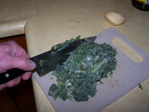 I'm cutting the kale into small pieces.
