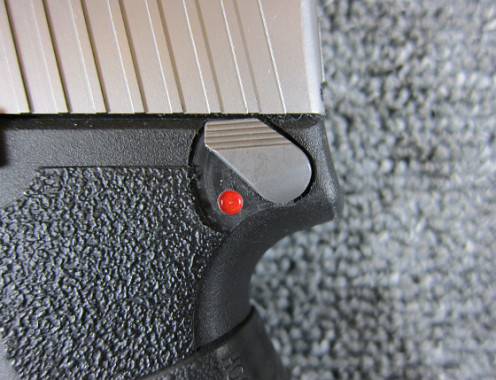 The red dot indicates that this safety is turned off and the gun is ready to fire.