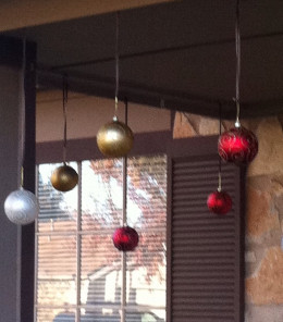 Hanging ornaments on the front porch