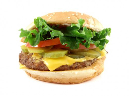 How about a burger with salad and cheese? You've got the meat which contains iron, salad  with tomatoes which contain iron, and Cheese with dairy for calcium. Delicious, not fattening and very healthy!