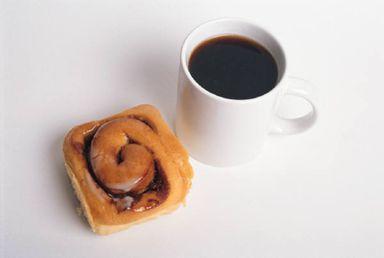 Enjoy a cup of cinnamon coffee with a cinnamon roll. Yummy!