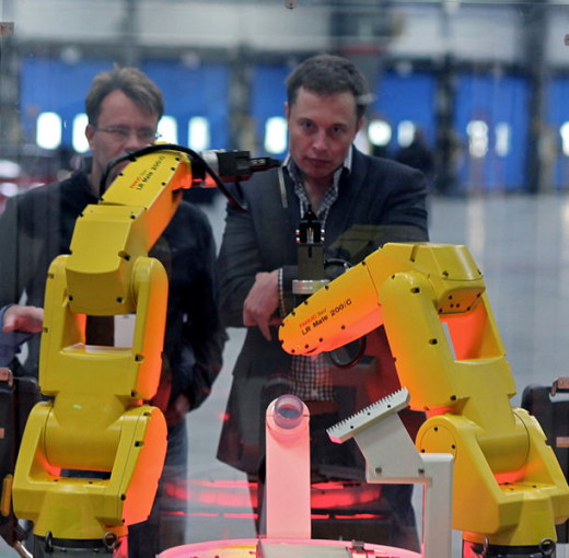 The yellow robot arms dance through an assembly demo for Elon Musk and the rest of the tour group that visited the reopening of the former NUMMI plant, now Tesla Motors.