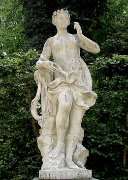 The Muse Erato--or possibly Euterpe, who is usually seen with an 'aulos', the instrument shown; Erato carries a lyre.  Either way, she is a musician.  Photo by Steffen Heilfort, courtesy Wikimedia Commons.
