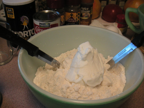 Add the shortening to the flour mix and blend this in using two knives.