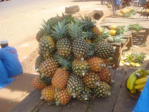 Pineapples on a fruit stand in a town in Africa
