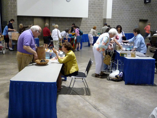 This photo taken by Bobak Ha'Eri, on July 11, 2009 in Madison, Wisconsin shows people speaking with Antiques Roadshow general appraisers.