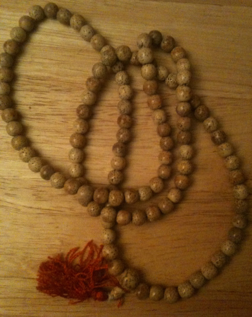 Prayer beads, or mala beads, can be helpful in meditation