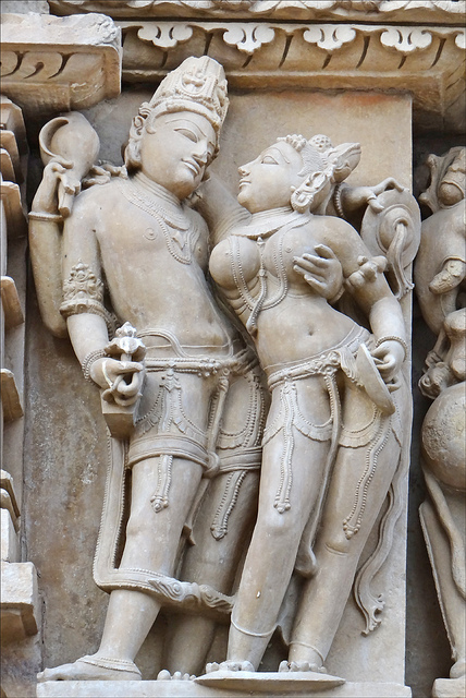 An intricate piece of sculpture inside the Khajuraho Temple in India showing a couple in love