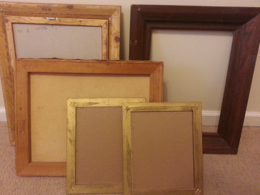 Collection of old wooden picture frames.