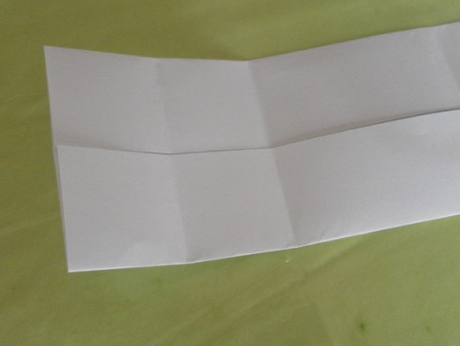 Unfold the paper. Yet another vertical crease line!