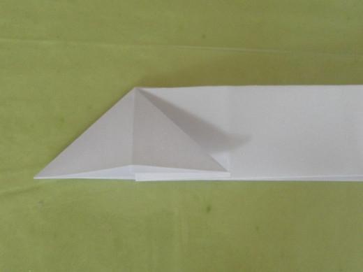 Open up the fold to make a triangle shape.