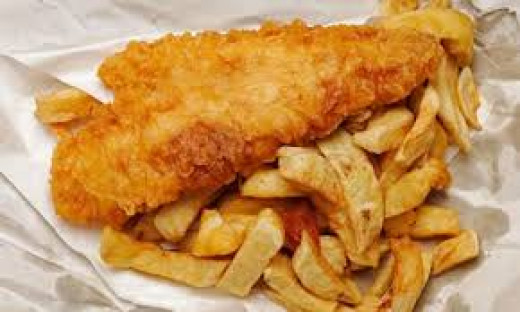 Cod & Chips, maybe scraps - wassat? In the north, at any rate, 'chippies' will ask 'D'you want scraps?' They're the bits of fried batter left on the rack behind the counter after the fish has been scooped up
