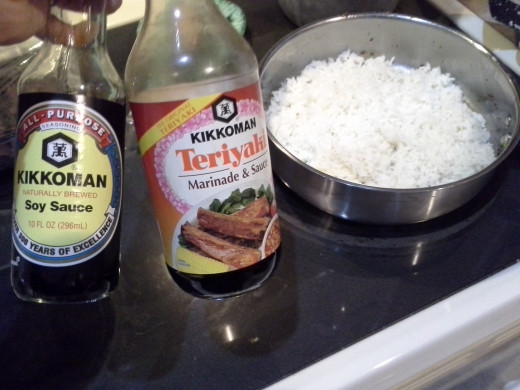 Step Seven: Add soy sauce and teriyaki to your rice