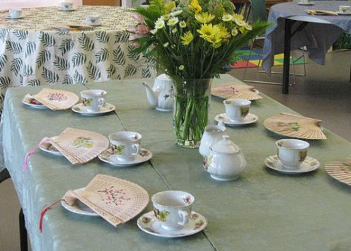 Decorate your table with playing card fans.