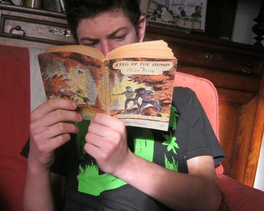 This is my teenage son reading the copy of Stig of the Dump that my father bought me. I loved reading it to him when he was little, and he still enjoys it even now. Value or what?