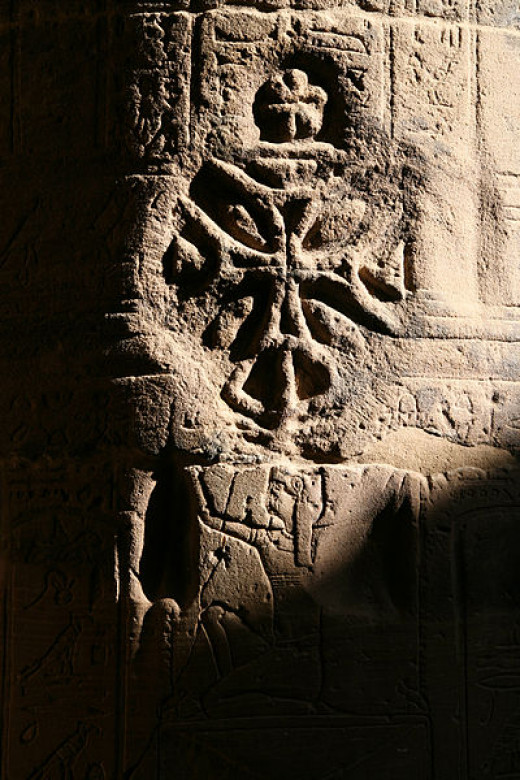 Coptic cross on older relief, Temple of Isis, Philae, Egypt.