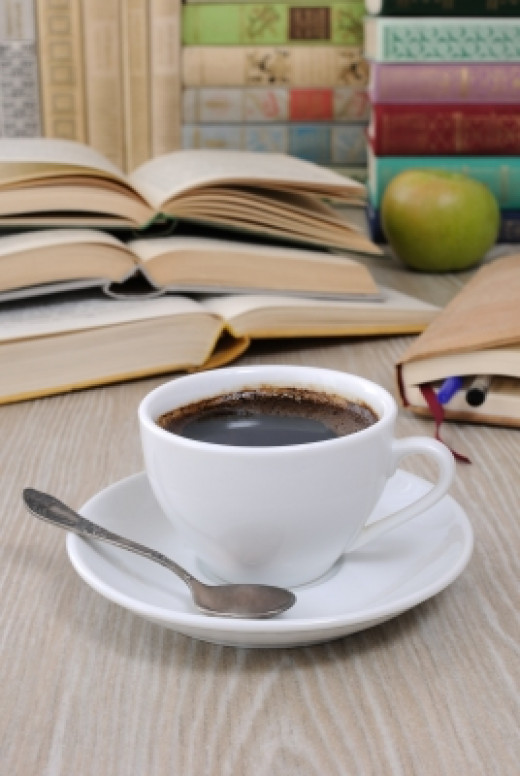 A Cup of Coffee on a Table among Books -also known as a good writing situation