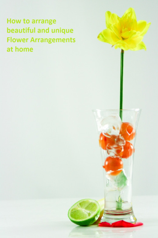 Sometimes adding some simple items to the bottom of a flower vase can add some drama to the arrangement.
