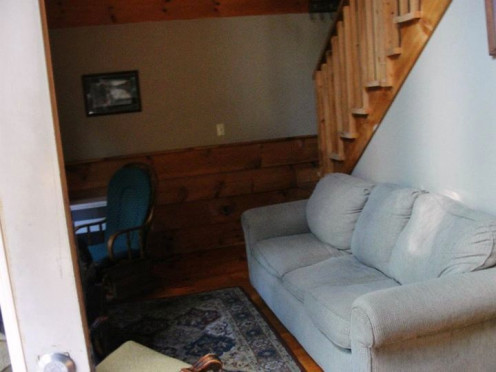 The living room of our Lakeside Cabin. Those stairs lead up to the loft.  That is the main door just to the left.