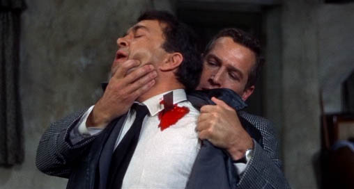 Prof. Michael Armstrong (Paul Newman) kills Hermann Gromek (Wolfgang Kieling) in Torn Curtain.