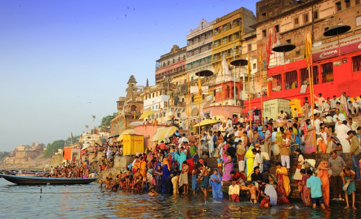 Pilgrims In Varanasi Taking A Dip In The Holy Ganges.