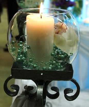 5. A candle in a lovely vase with a flower and some beads can look great in the centre of your table.