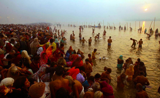 Pilgrims Taking The Ritual Bath During Maha Kumbh Mela.