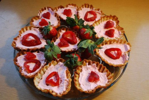Some simple pastries filled with pink cream and a strawberry can look fantastic.
