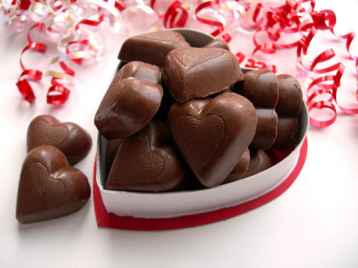 You can buy some heart shaped sweet in your sweet shop and present them in a lovely heart shape box.