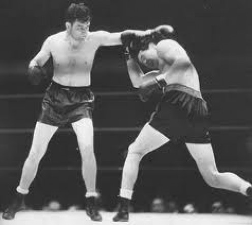 Max Baer, pictured fighting Jimmy Braddock, was a former heavyweight champion who possessed a huge knockout punch.