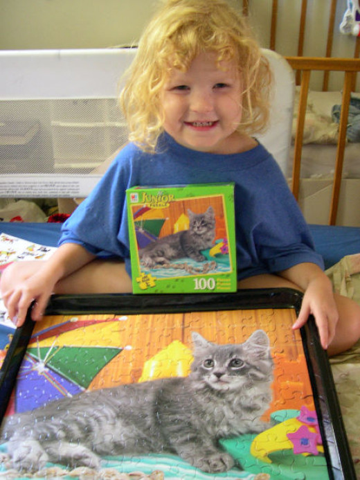 For young children, you can get easy jigsaws  which adorable designs which they will be able to assemble.