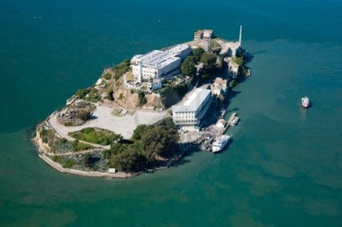 Alcatraz was a maximum security prison located in the water in San Francisco, California. It is located 1.5 miles from off shore. Now it's a tourist destination that is visited by thousands annually.