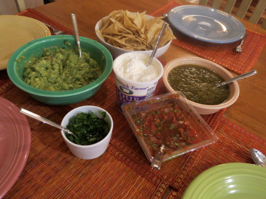 Assemble the garnishes: guacamole, salsa, sour cream and cilantro