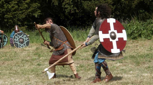 Holmgang with axes - the holmgang area, literally fight on an eyot, was marked in a square traditionally by hazel twigs. The first to step outside the 'arena' lost the fight by default