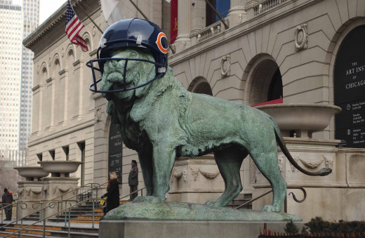Art Institute Lions wearing Chicago Bears helmets
