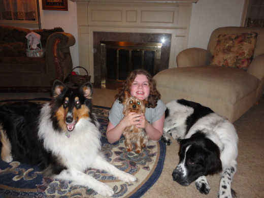 My daughter with her dog family; they have helped her learn compassion, responsibility and how to love without end.