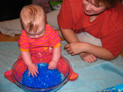 Water beads / vase filler are an awesome tactile / sensory material for babies.