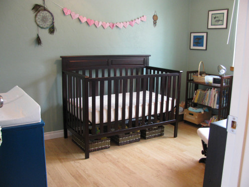 Displaying a paper heart banner or other simple décor item in a baby's room adds the perfect decorative touch.